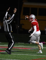 Canandaigua's Matt Vierhile tosses the ball in the end zone after scoring the first touchdown of the game against Victor on Sept. 12. The same teams meet again on Friday night.