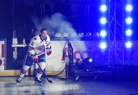 Rochester Americans captain Kevin Porter is introduced prior to the season opener against the Charlotte Checkers Friday night at Blue Cross Arena. Charlotte beat the Rochester Americans 6-2 before a crowd of 5,203.