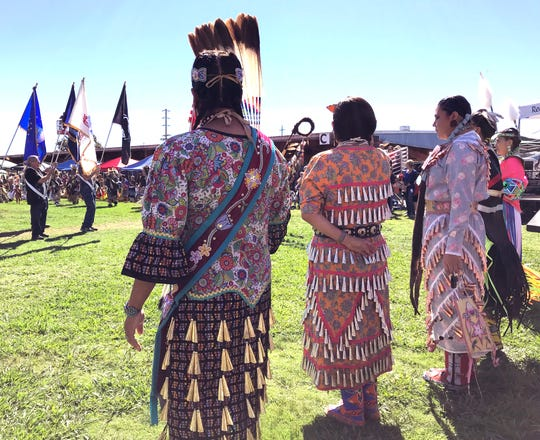 Dancers at the Stillwater Powwow 2018 make their grand entry Saturday afternoon at the Shasta District Fair grounds in Anderson.