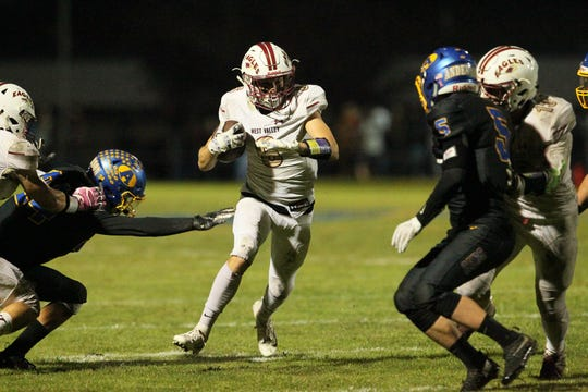West Valley's Dagen Johnson-Sanders (6) runs through a hole to score a 2-point conversion late in the 4th quarter against Anderson. The Eagles defeated the Cubs, 26 - 0, in Anderson on Friday Oct. 5, 2018.