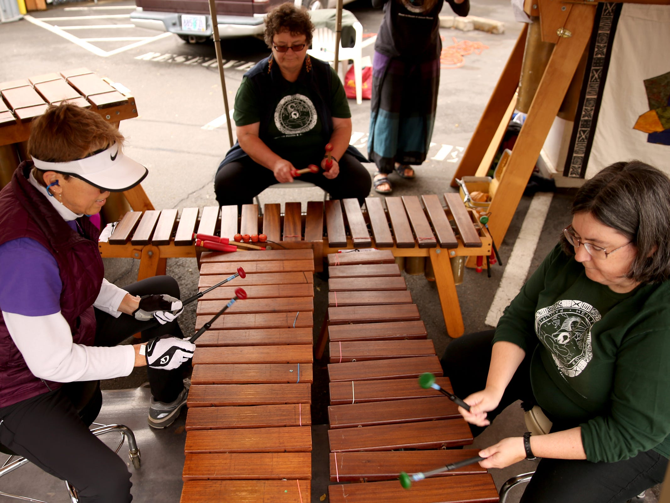 Marimba players perform during the Silverton Sidewalk Shindig, a culture of music festival, in downtown Silverton on Saturday, Oct. 6, 2018.