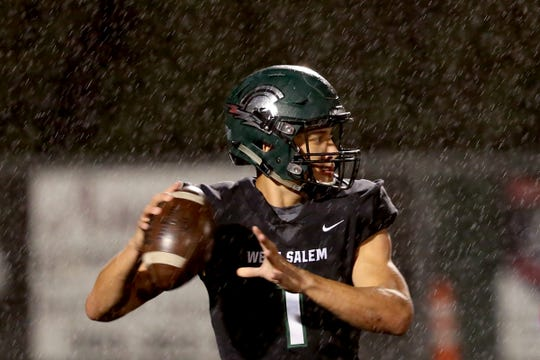 West Salem's Simon Thompson (1) looks to pass in the first half of the South Salem vs. West Salem football game at West Salem High School on Friday, Oct. 5, 2018.