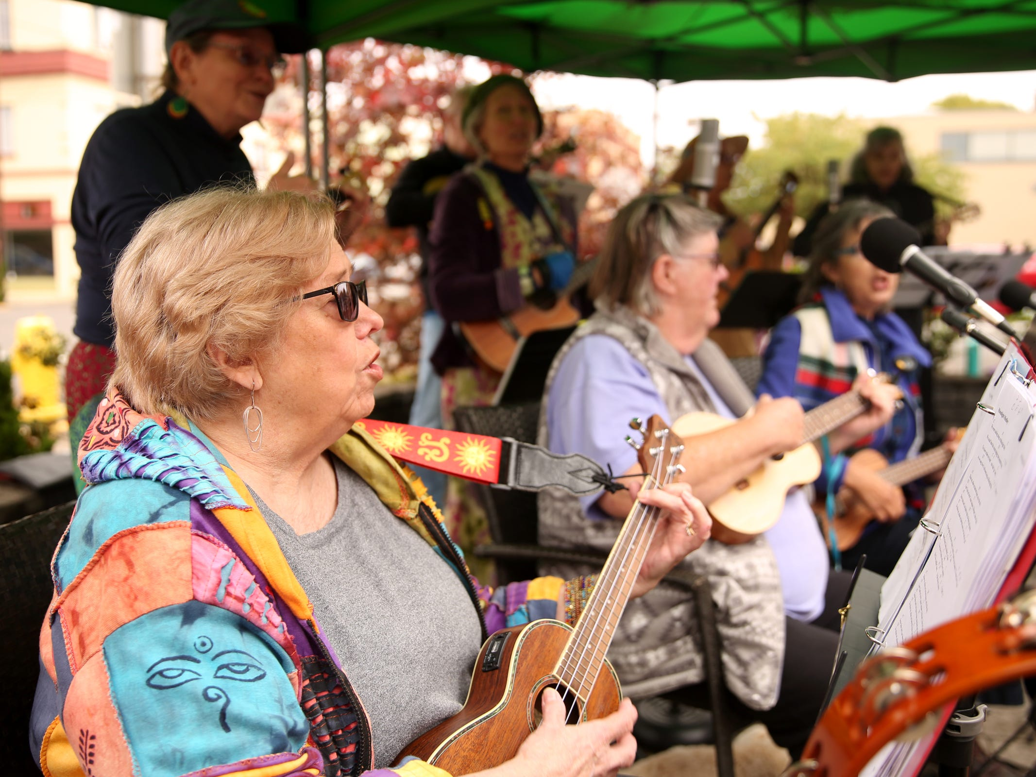 The Silverton Ukulele Network performs during the Silverton Sidewalk Shindig, a culture of music festival, in downtown Silverton on Saturday, Oct. 6, 2018.