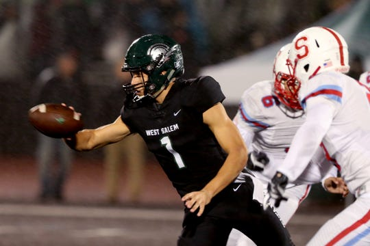 West Salem's Simon Thompson (1) pitches the ball in the first half of the South Salem vs. West Salem football game at West Salem High School on Friday, Oct. 5, 2018.