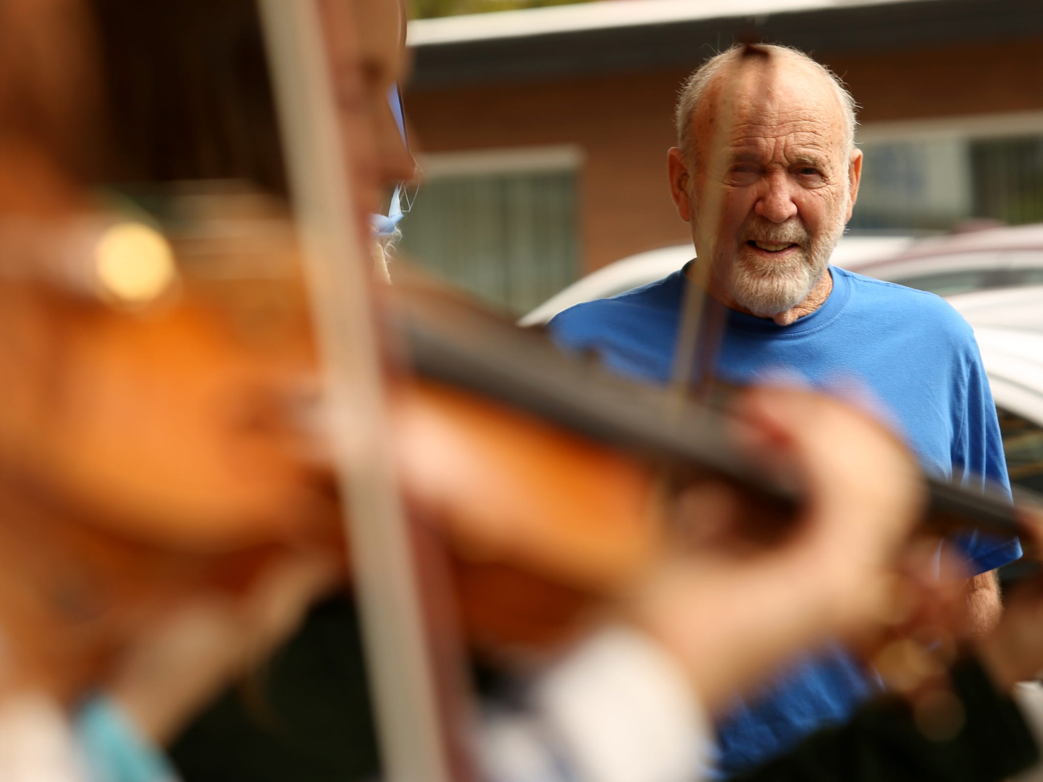 Ron Keppinger, of Silverton, watches violinists perform during the Silverton Sidewalk Shindig, a culture of music festival, in downtown Silverton on Saturday, Oct. 6, 2018.