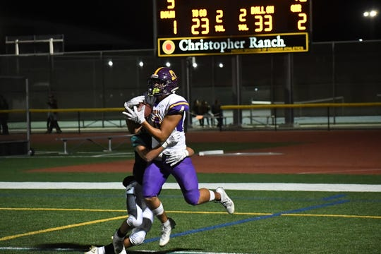 Salinas wide receiver Ivan Curiel Jr. (4) catches on of his two touchdowns in Friday night's game.