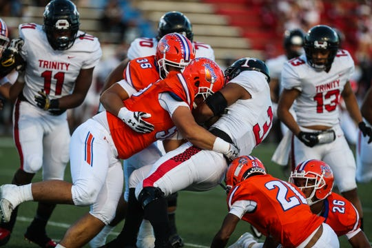 Central's defense takes down a Euless Trinity ball carrier Friday, Oct. 5, 2018, at San Angelo Stadium.