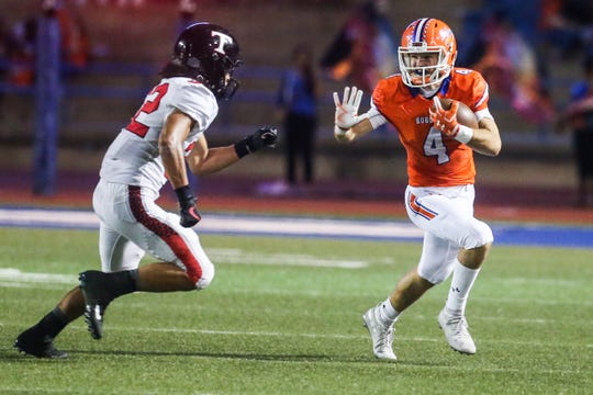 Central's Jackson Timme runs the ball as Trinity defense approaches Friday, Oct. 5, 2018, at San Angelo Stadium.