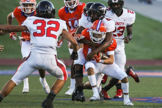 Central's Tristan Lopez is tackles by Trinity defense Friday, Oct. 5, 2018, at San Angelo Stadium.