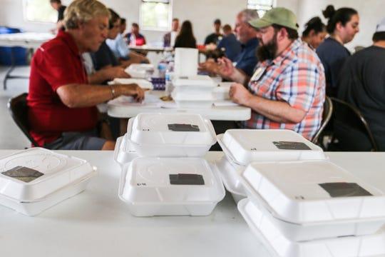 Judges get ready to sample ribs during Brews, Ewes & BBQ Saturday, Oct. 6, 2018, at El Paseo de Santa Angelo.