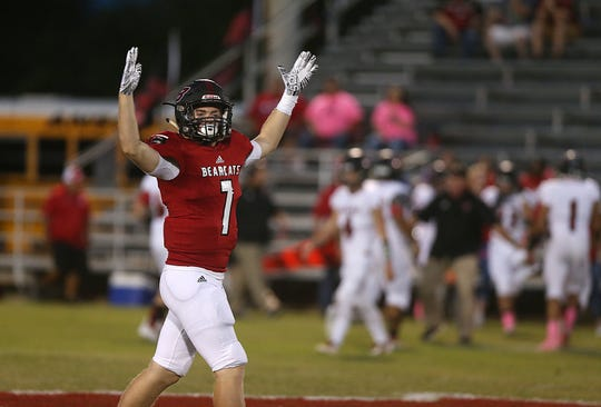 Ballinger's Tyler Vaughn (#7) pumps up the crowd during the game Friday, Oct. 5, 2018, in against Anson.