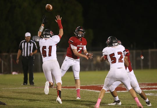 Ballinger's Tyler Vaughn throws a pass over the head of an Anson player at the game Friday, Oct. 5, 2018, in Ballinger.