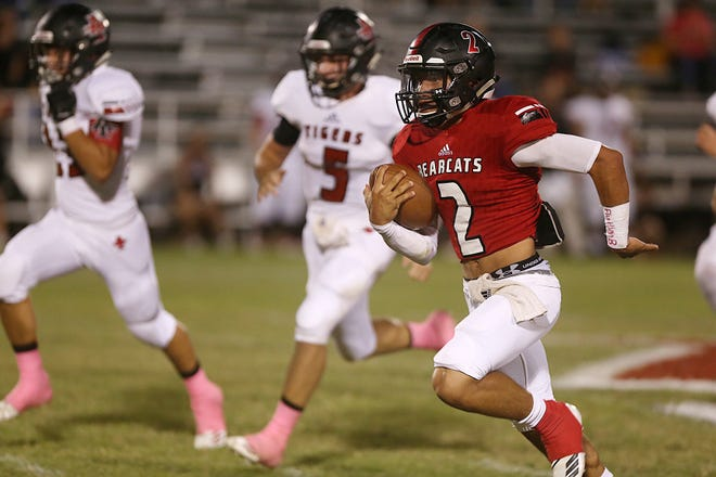Ballinger's Edgar Nunez (2) is chased down field just before making a touchdown during the Bearcats' homecoming win over Anson on Friday.