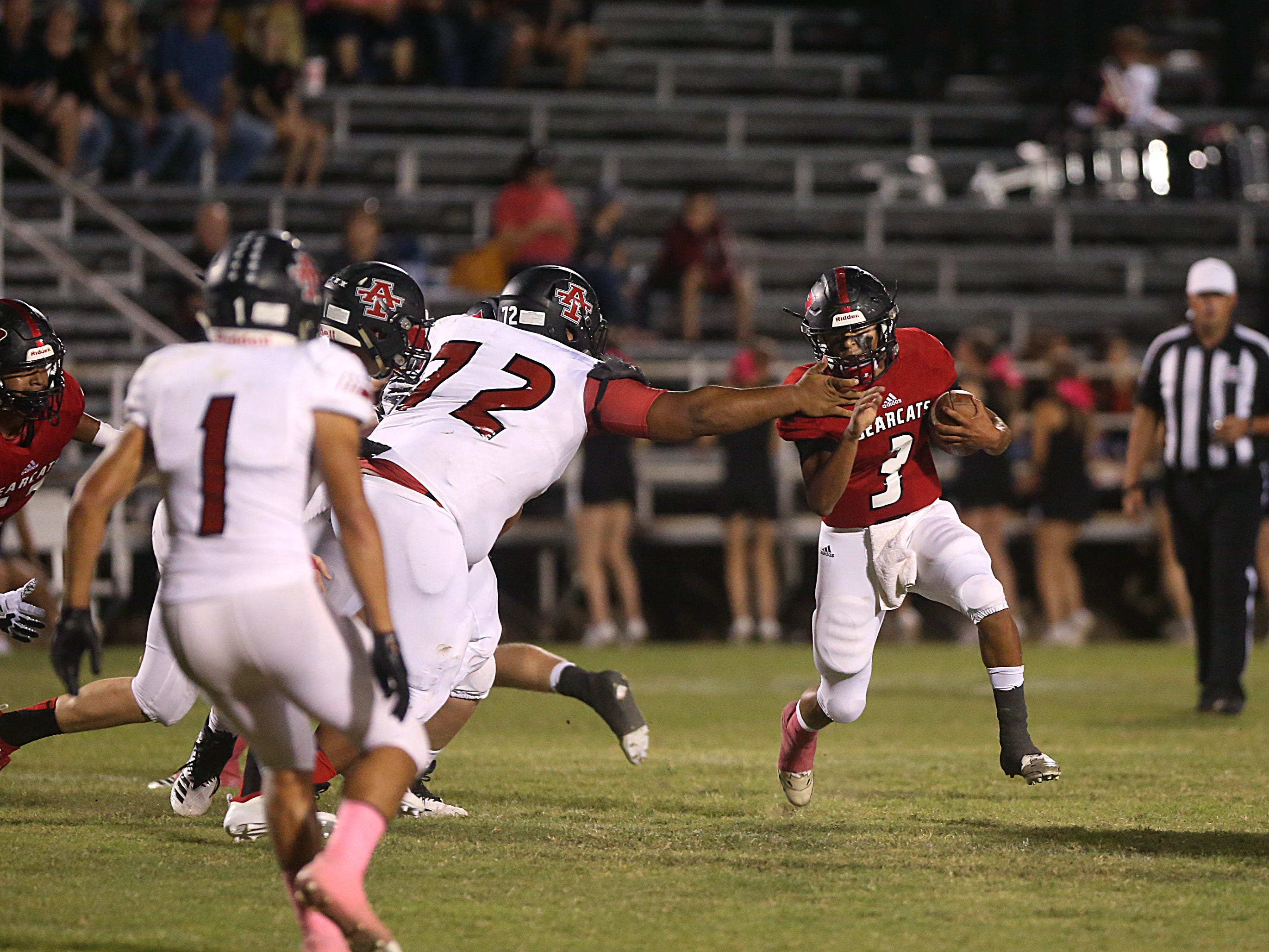 Ballinger's Damian Willborn (#3) dodges the grasp of Anson's Michael Stamper (#72) during the game Friday, Oct. 5, 2018, in Ballinger.