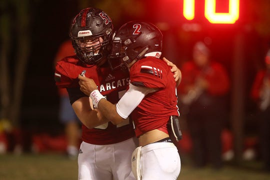 Ballinger's Edgar Nunez (#2) and teammate Colton Belk (#52) celebrate after a touchdown during the game Friday, Oct. 5, 2018, in Ballinger against Anson.