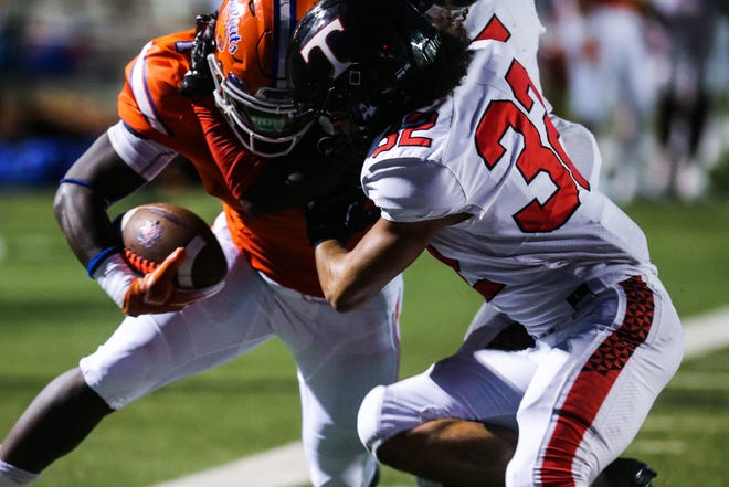 A San Angelo Central ball carrier is tackled by a Euless Trinity defender during their football game Friday, Oct. 5, 2018, at San Angelo Stadium.