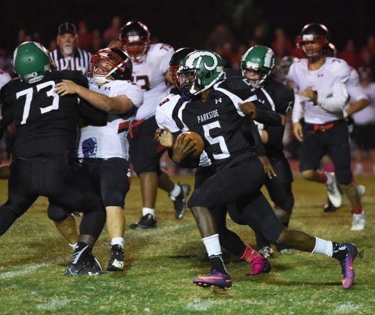 Parksides Marcus Yarns runs the ball during action Friday night at the James M. Bennett High School vs Parkside High School Football game. Bennett won the game 21-7. (Photo by Todd Dudek for The Daily Times)