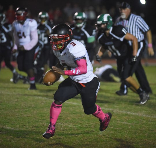 SaQuan Cotton runs the ball during action Friday night at the James M. Bennett High School vs Parkside High School Football game. Bennett won the game 21-7. (Photo by Todd Dudek for The Daily Times)