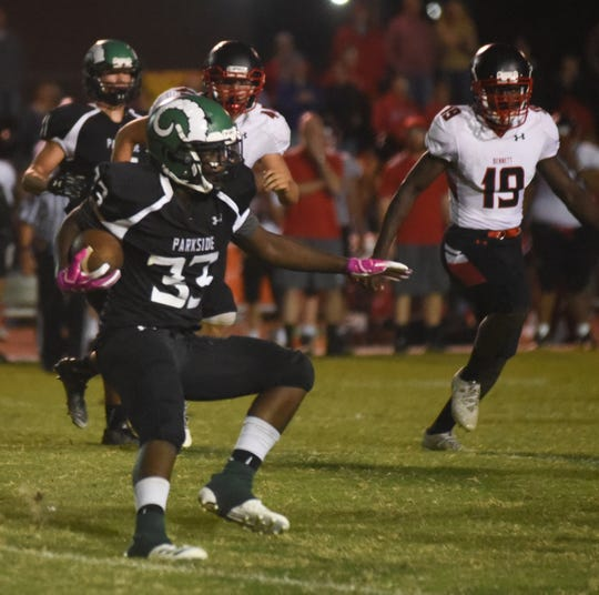 Parkside's JaBrontae Mills runs with the ball during action Friday night at the James M. Bennett High School vs Parkside High School Football game7. (Photo by Todd Dudek for The Daily Times)