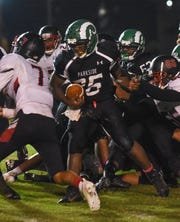 Parksides Alijah Bivans runs the ball during action Friday night at the James M. Bennett High School vs Parkside High School Football game. Bennett won the game 21-7. (Photo by Todd Dudek for The Daily Times)