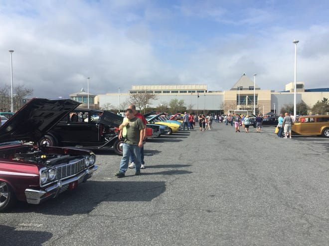 Hundreds of people walk around the Convention Center parking lot in Ocean City to see a variety of classic cars on display for the Endless Summer Cruisin' car show.