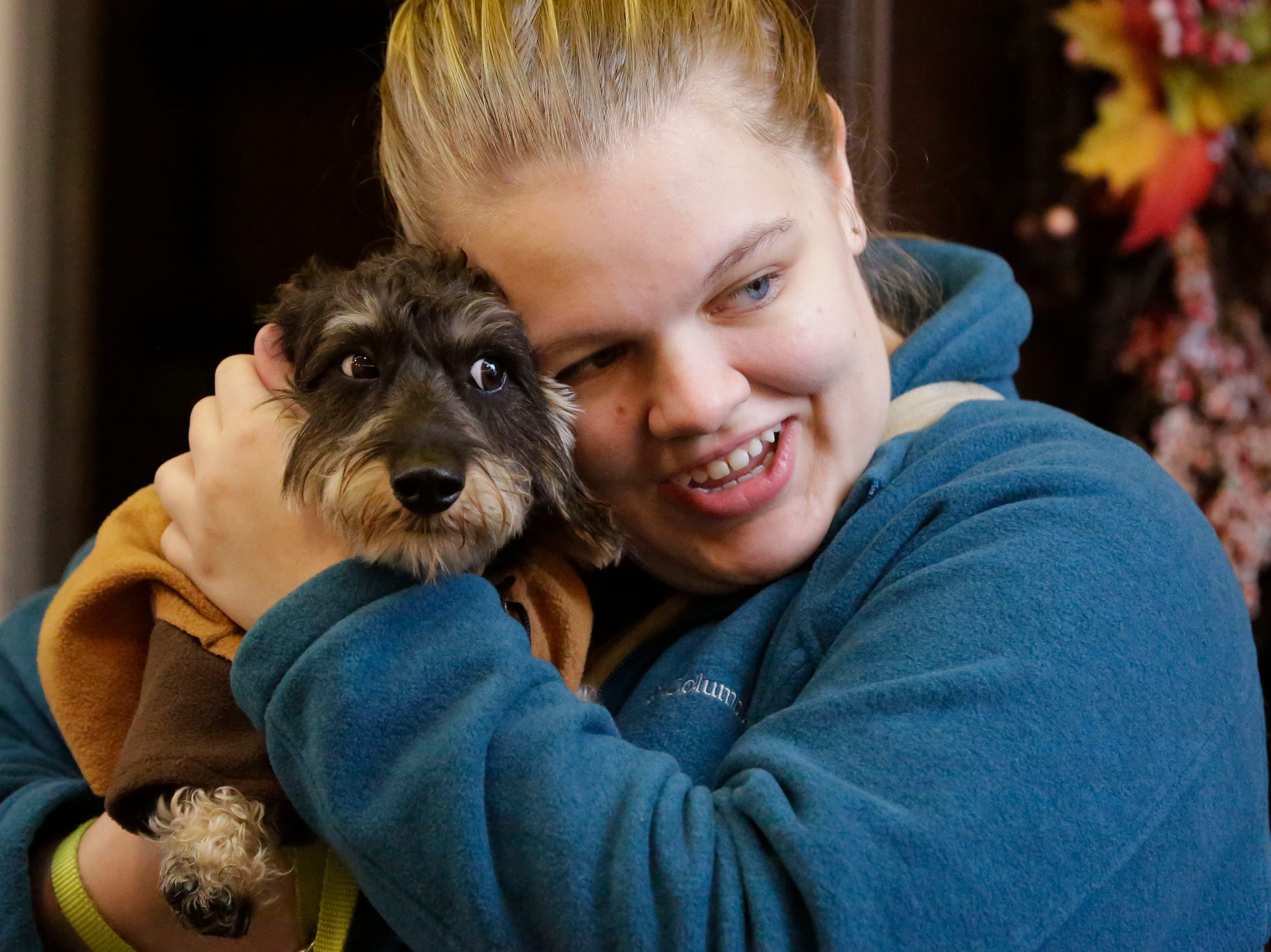 Shannon Smies of Sheboygan holds her dog Draco who is dressed as an Ewoc at Al and Al's Oktoberfest festivities, Saturday October 6, 2018, in Sheboygan, Wis.