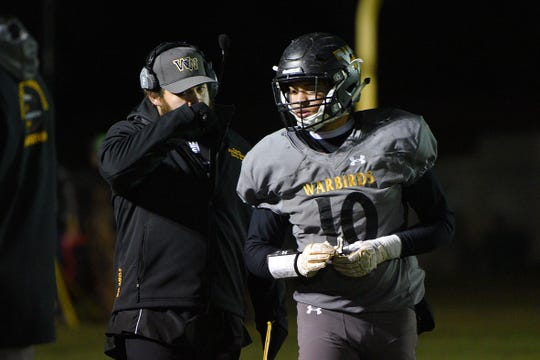 Wolsey-Wessington's assistant coach Hayden Hooks talks to his brother, Brevan Hooks during the game against Gregory Friday, Oct. 5, in Wolsey.