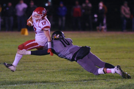 Wolsey-Wessington's Brevan Hooks tackles Gregory's Caleb Stukel during the game Friday, Oct. 5, in Wolsey.
