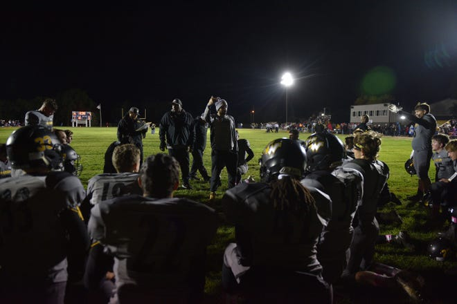 Wolsey-Wessington huddles at half time during the game against Gregory Friday, Oct. 5, in Wolsey.
