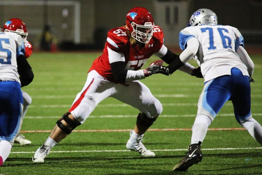 Lincoln Patriot's linemen and Iowa State recruit #57 Grant Treiber blocks during their win Friday night.