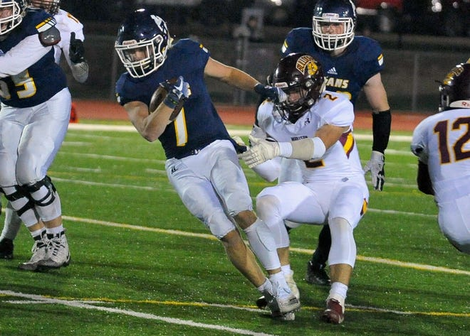 Tea's Carter Slykhuis is brought down by Madison's Mason Avery on Friday, Oct. 5, in Tea.