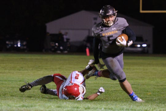Wolsey-Wessington's Devante Luellman goes against Gregory's Evan Juracek during the game Friday, Oct. 5, in Wolsey.