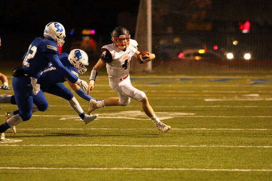 Jett McGirr of Huron is run down by Evan Wittry of O'Gorman during Friday night's game in Sioux Falls.
