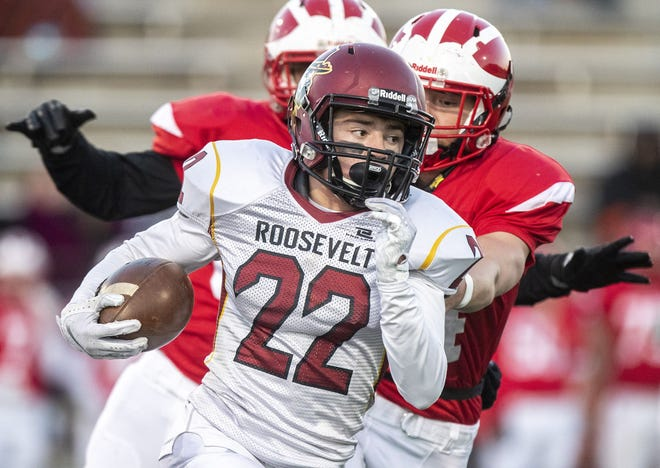 Tucker Large, of Sioux Falls Roosevelt, runs the ball Friday during a game against Rapid City Central at O'Harra Stadium.