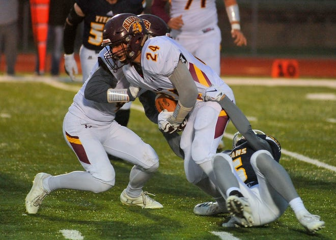 Madison's Thomas Gors is brought down by Tea's Brayden Thompson on Friday, Oct. 5, in Tea.