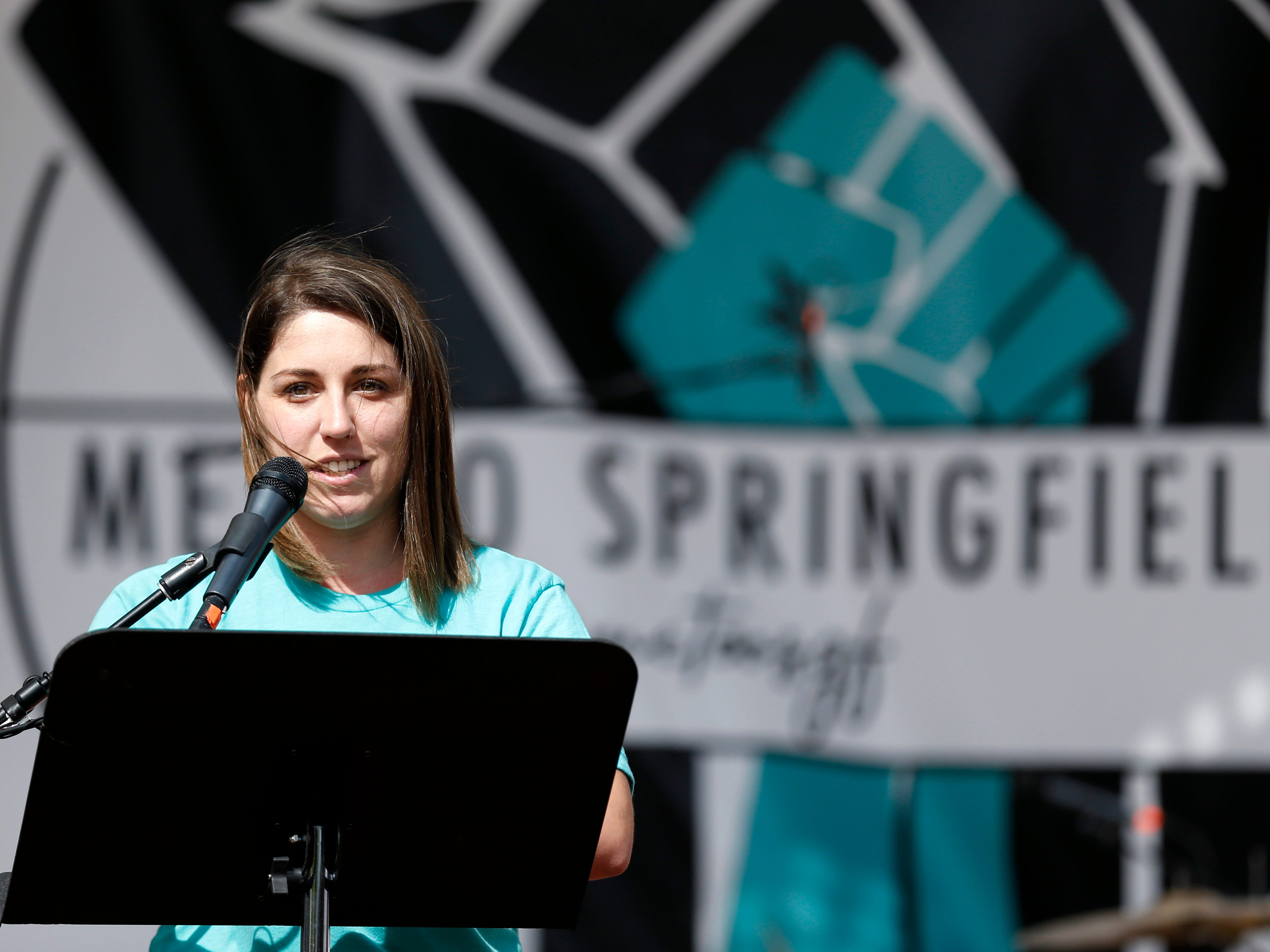 Rep. Crystal Quade, D-Springfield speaks to a crowd of a few hundred people at the Me Too Springfield rally in downtown Springfield on Saturday, Oct. 6, 2018.