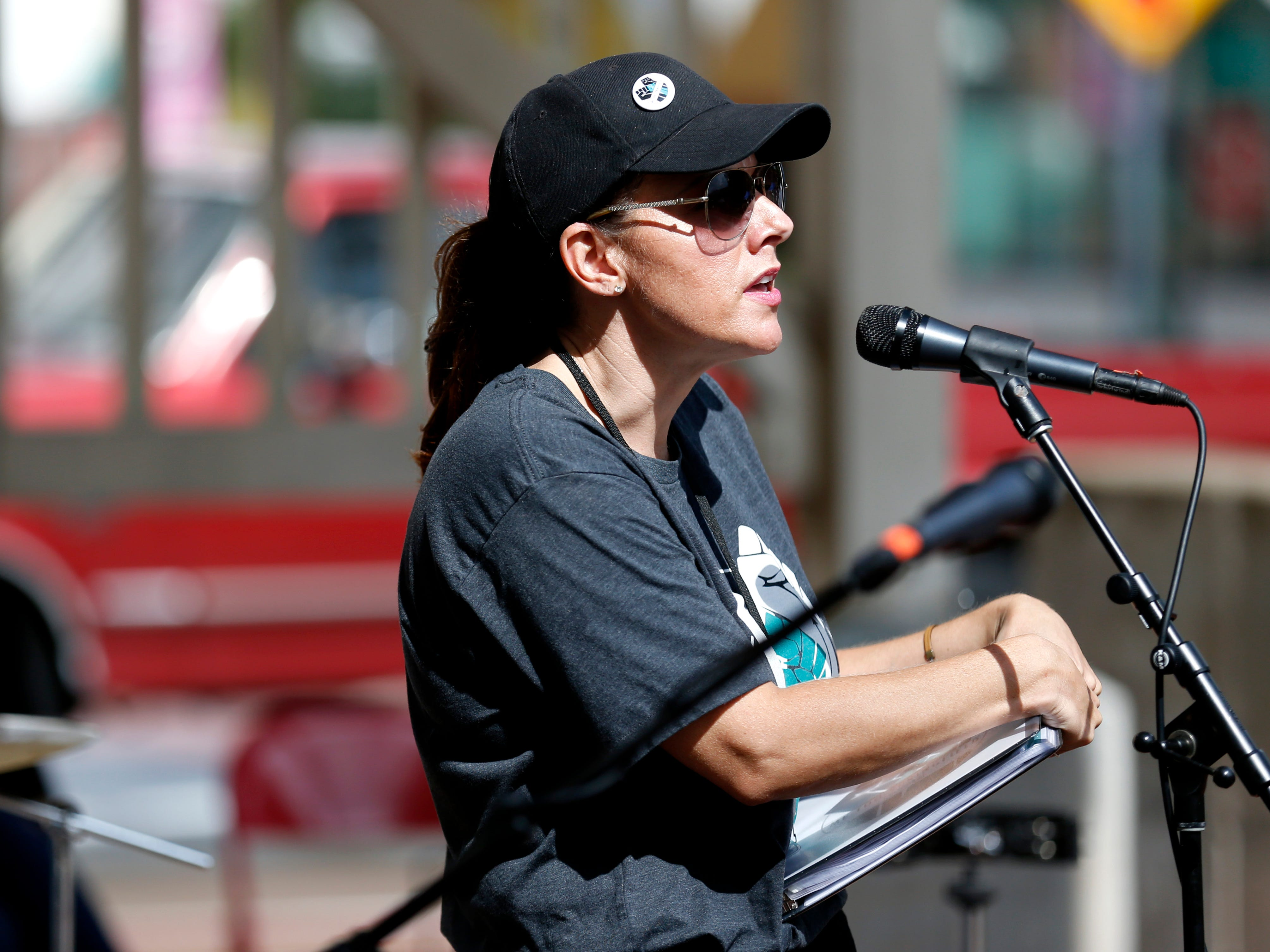 Sarah Bargo, one of the organizers of the #MeToo rally in downtown Springfield, speaks to the crowd during the event on Saturday, Oct. 6, 2018.