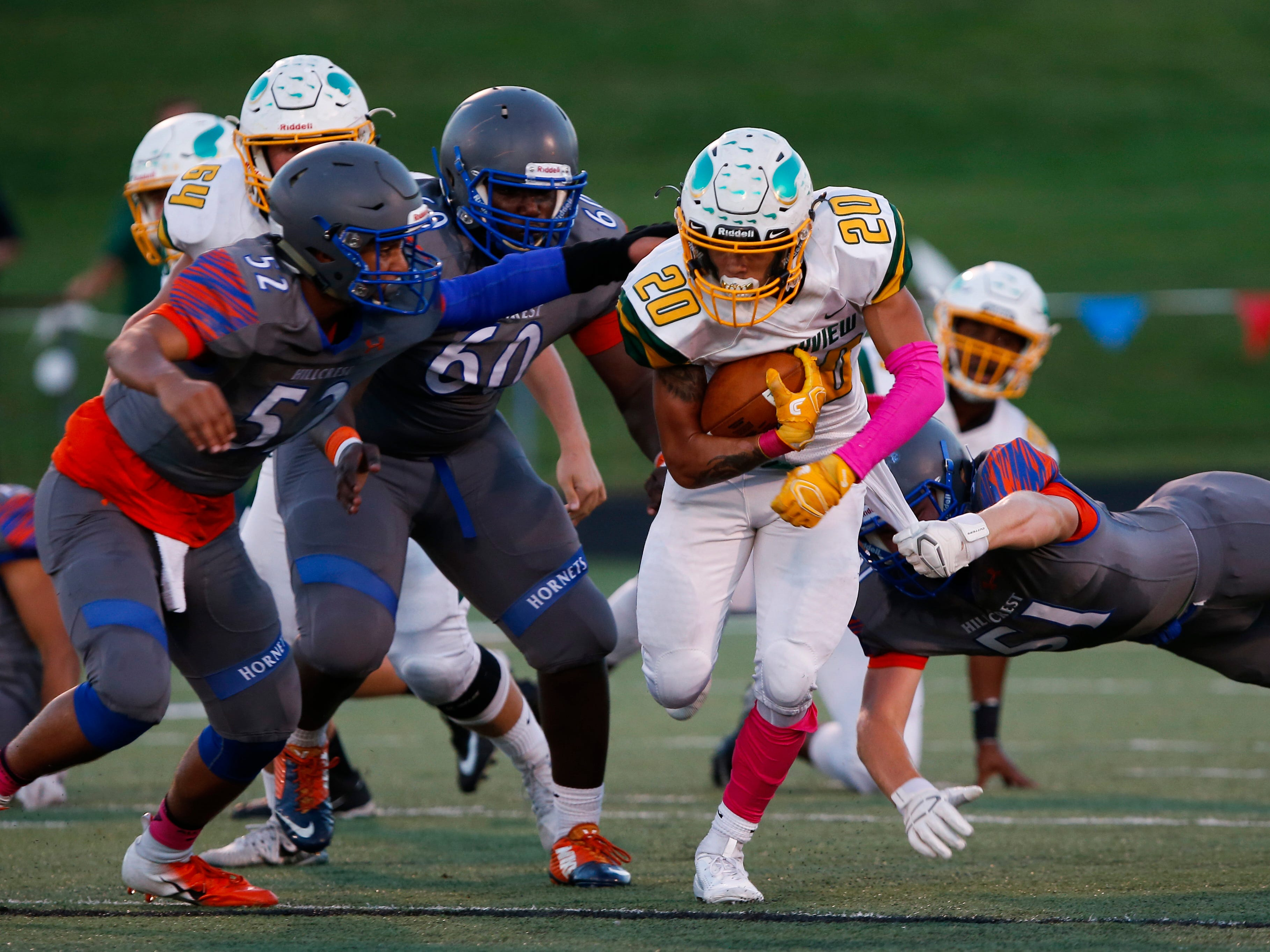 Parkview's Jevin Huddleston carries the ball through a swarm of Hillcrest Hornets during a game at Hillcrest on Friday, Oct. 5, 2018