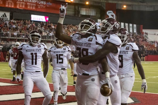 Missouri State's Antwan Woods (88) celebrates after scoring a touchdown during a game against the University of South Dakota, Saturday, Oct. 6, 2018 in Vermillion, S.D.