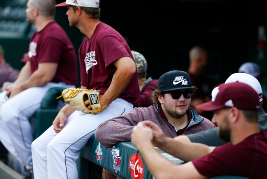 Jake Burger talks with other former Missouri State Bears baseball players during an alumni baseball game at Hammons Field on Saturday, Oct. 6, 2018.