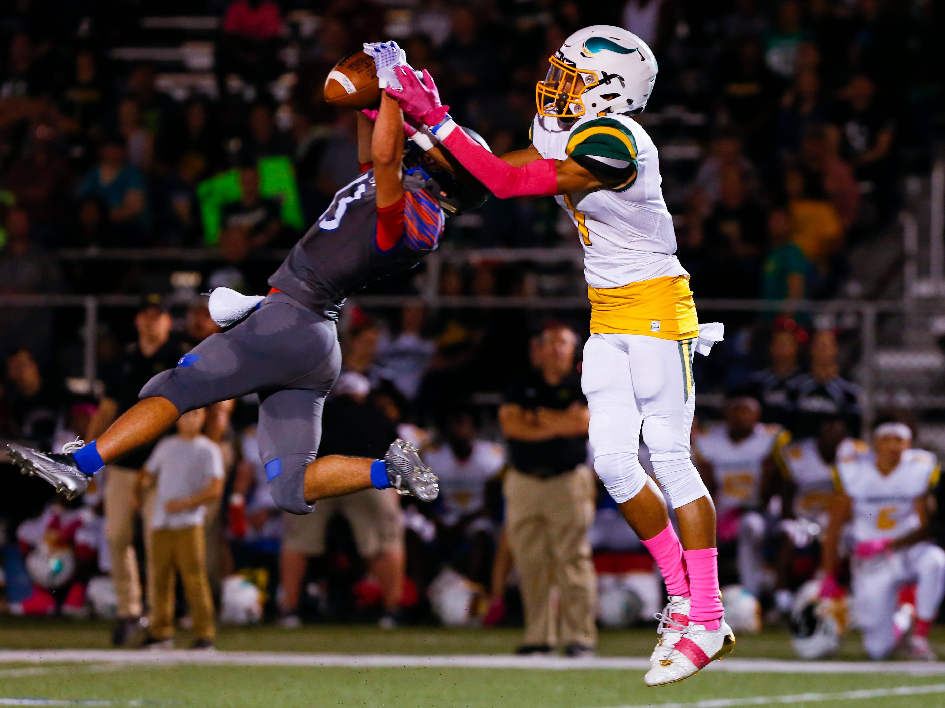 Hillcrest Hornets' Samson Cochran narrowly misses making an interception as Parkview's Tyrone Newburn breaks up the interception attempt during a game at Hillcrest on Friday, Oct. 5, 2018