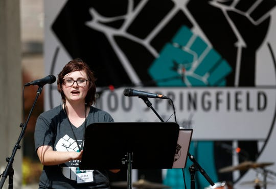 Jordan Harris, an organizer of the Me Too Springfield rally in downtown Springfield, shares her story of sexual assault with the crowd at the rally on Saturday, Oct. 6, 2018.