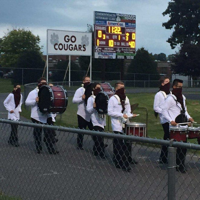 The Stuarts Draft band takes cheers on the Cougars football team Friday night.