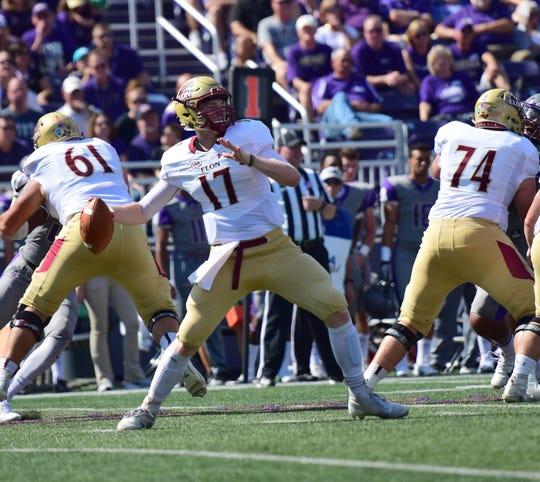 Elon quarterback Davis Cheek unloads a pass against James Madison in the first half of the Dukes' 27-24 Colonial Athletic Association loss to Phoenix on Saturday, Oct. 6, 2018, at Bridgeforth Stadium in Harrisonburg, Va.