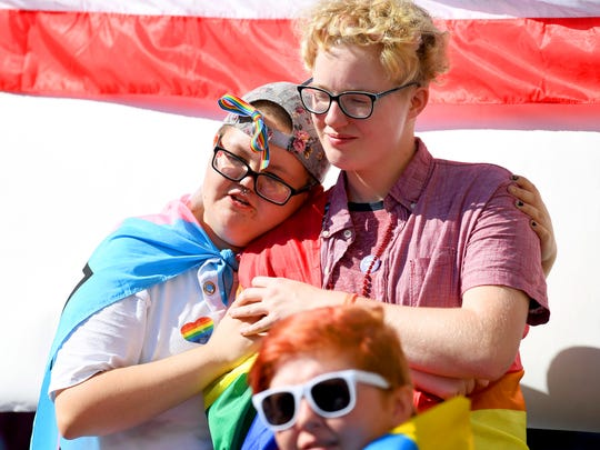 Jay Cropper and Chris Stover, both students at Mary Baldwin University, share a moment while at the Staunton Pride festival in downtown Staunton on Saturday, Oct. 6, 2018.