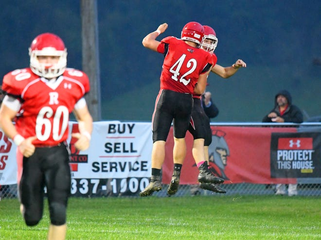 Riverheads' Moose Lee (#42) congratulates teammate Zac Smiley who just scored a touchdown on a 90 yard return of the opening kick during a game played in Greenville on Friday, Oct. 5, 2018.