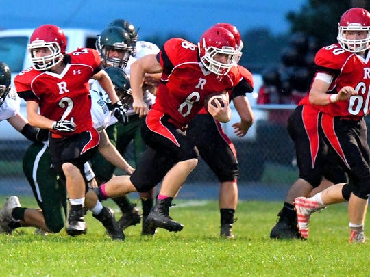 Riverheads' Zac Smiley breaks through the line and takes off with the ball after receiving the opening kick during a game played in Greenville on Friday, Oct. 5, 2018.