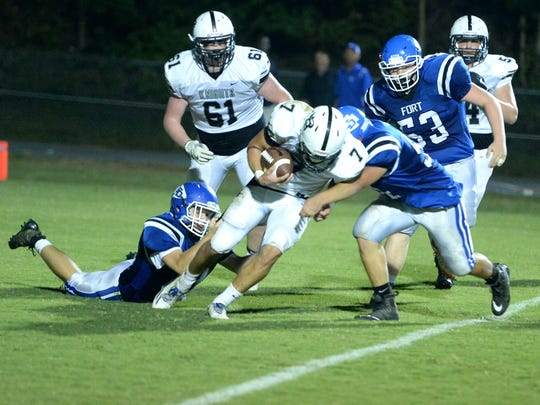 Fort Defiance defenders sack Turner Ashby quarterback Tyler Quick in the end zone for a safety and a 9-3 lead in the third quarter Friday night.