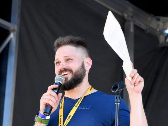 Chris Wood addresses those gathered at the stage during the Staunton Pride festival in downtown Staunton on Saturday, Oct. 6, 2018.