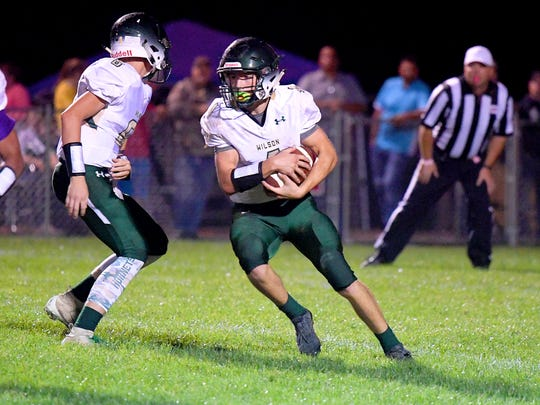 Wilson Memorial's Ty Hevener takes off with the football after receiving the handoff from quarterback Kaden Welcher during a game played in Greenville on Friday, Oct. 5, 2018.